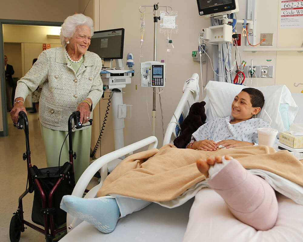 Mrs. Bush visits a patient in the hospital