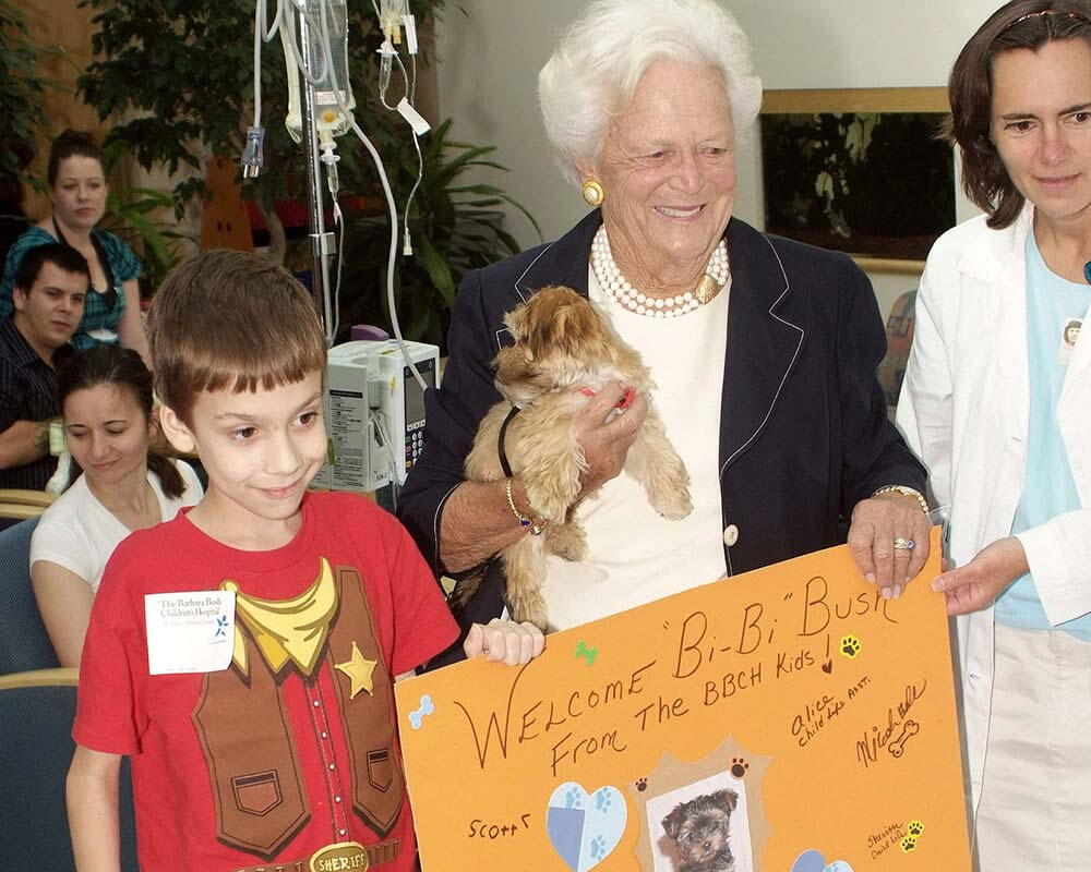 Mrs. Bush with a card from patients