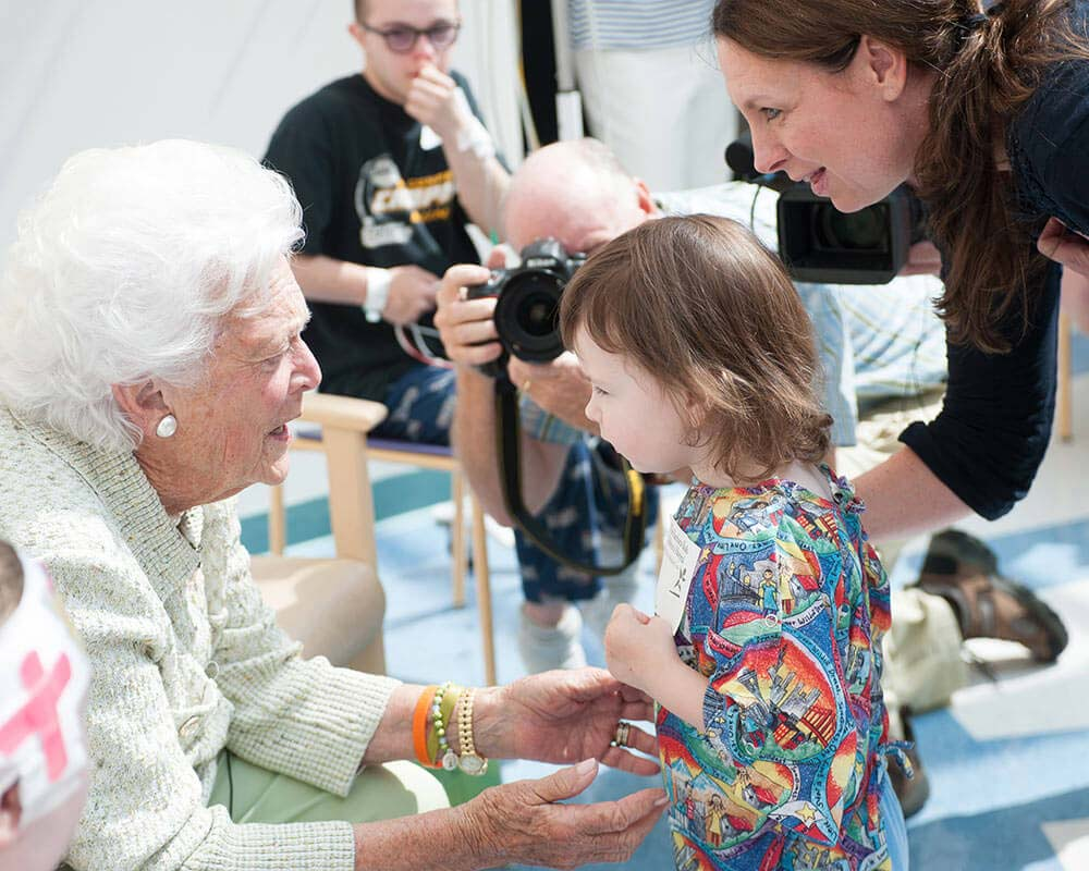 Barbara Bush says hello to a patient