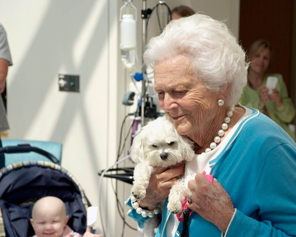 Barbara Bush and her puppy at the children's hospital