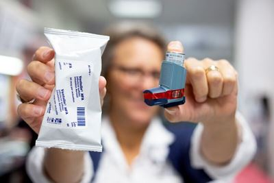 doctor holding up inhaler medication