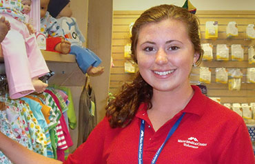 Smiling volunteer in the gift shop