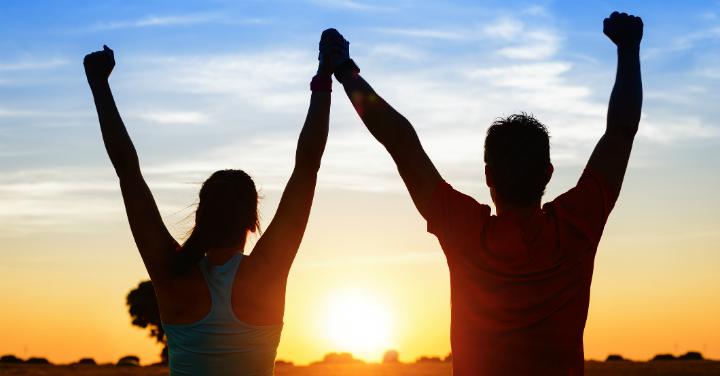 Couple celebrating during sunset