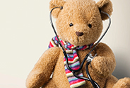 Teddy bear wearing a stethoscope