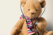 Teddy bear wearing a stethoscope