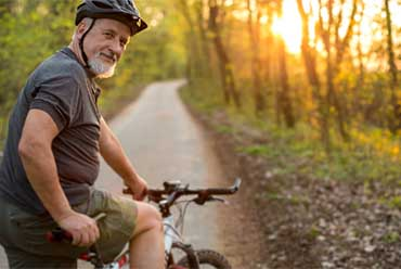 man on bike in woods