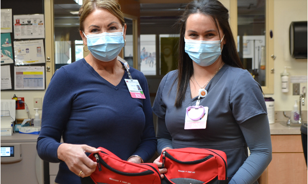 Two nurses holding prevention kits