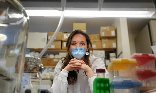 girl with face mask in a lab