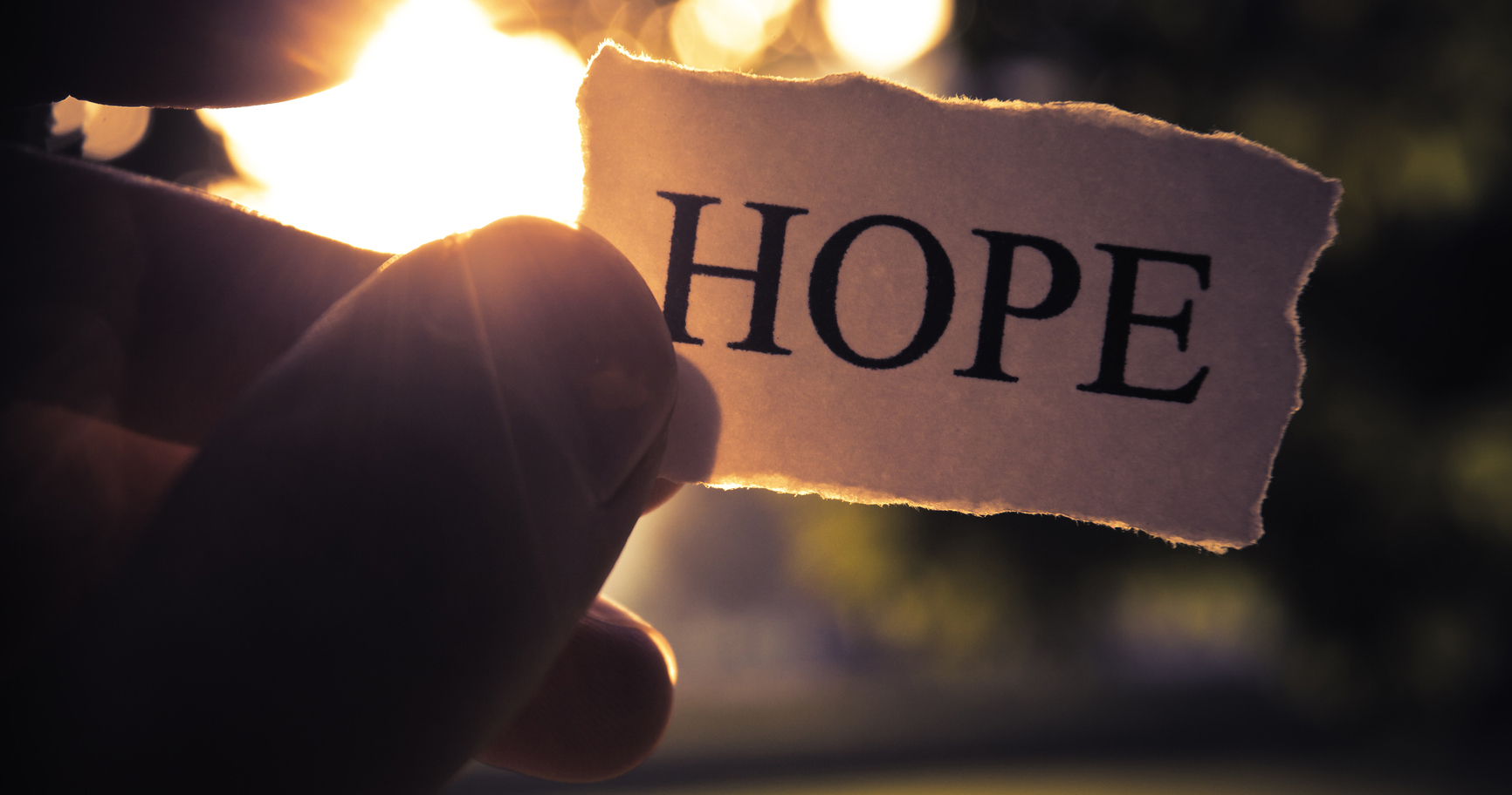 small piece of paper with the word Hope
