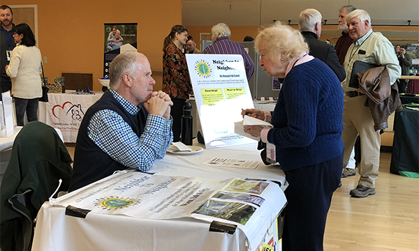 An exhibitor talks with a participant at last year's Caregiver Expo.