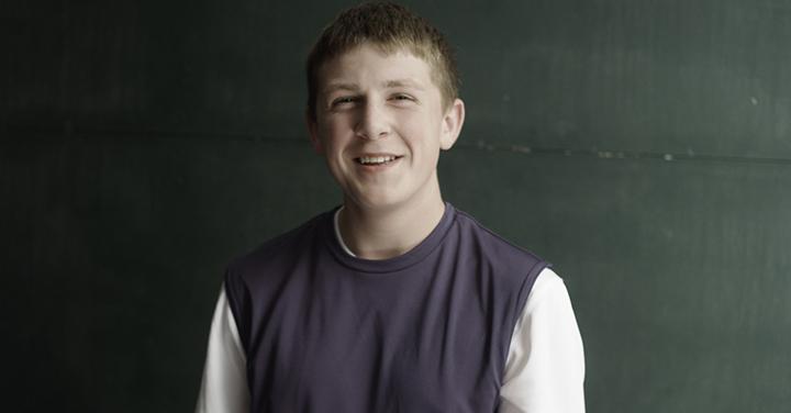 Teenage boy in a gray vest