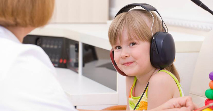 Young girl wearing head phones in the doctor's office
