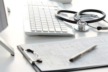 Keyboard, clipboard and stethoscope on a desk