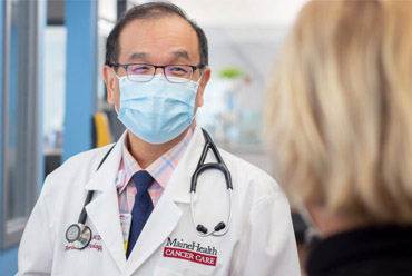 Asian American Doctor Talking to a Patient